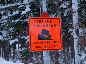 Caution, steep hill ahead sign, chains required, monitor LADD1